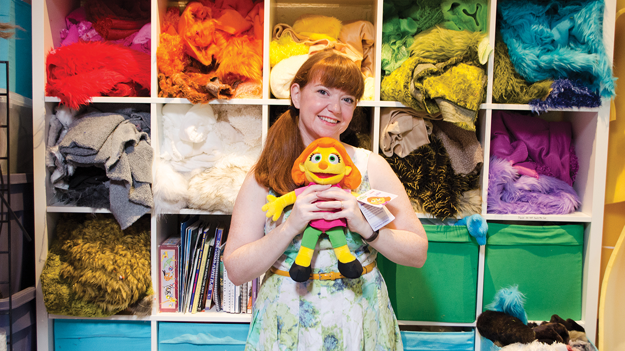 Puppeteer Stacey Gordon with Julia, the character she plays on Sesame Street.