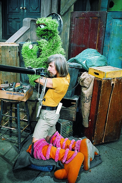 Caroll Spinney performing Oscar the Grouch while in his Big Bird legs (Courtesy of Sesame Workshop)