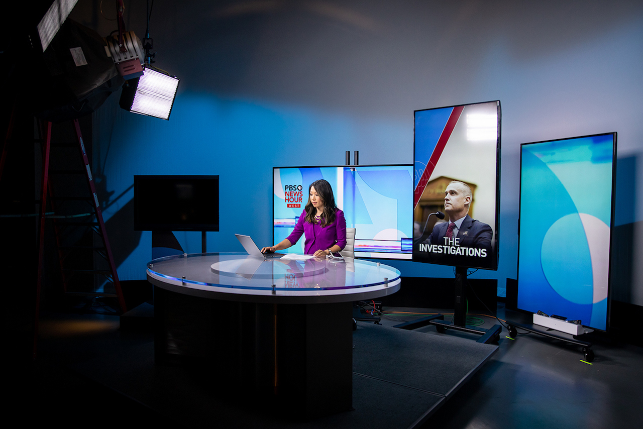 Stephanie Sy at the anchor desk of PBS NewsHour West