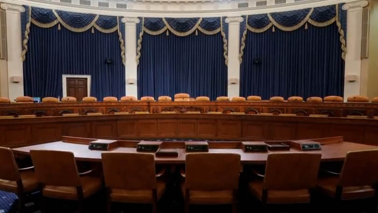 An empty congressional hearing room