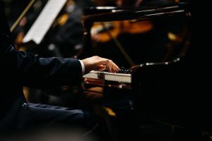 hands of pianist on keyboard