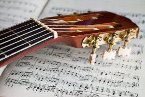 classical guitar headstock on manuscript