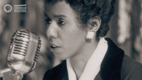 Lorraine Hansberry talking into a microphone
