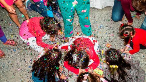 Children play with confetti
