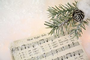 Silent Night score with pine leaf