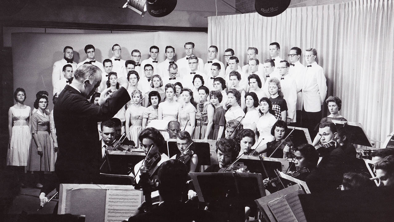 David Scoular conducts the ASU Chorus in Arizona PBS' studios in the early 1960s.
