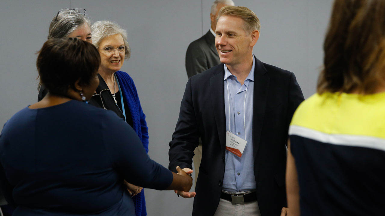 Participants in the Public Media Diversity Leaders Initiative greet each other.
