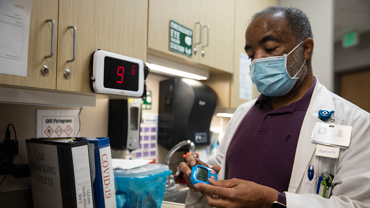 Dr. George Thomas works at his office, the Family Health Center in Hayneville, Alabama. Thomas is the sole physician in Lowndes County, a rural region of about 10,000 people. (Amanda Paule/News21)