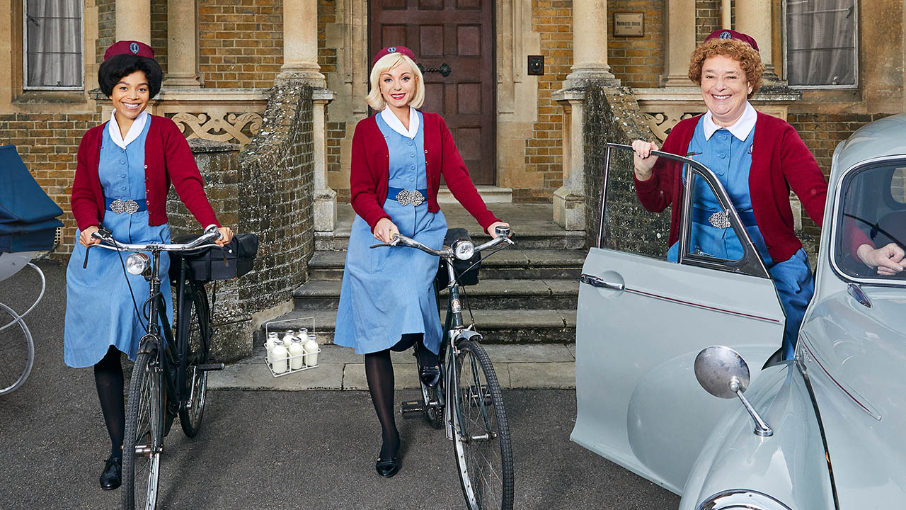 Nurse Lucille Anderson (Leonie Elliott) and Nurse Trixie (Helen George) stand with their bicycles, while Nurse Phyllis Crane (Linda Bassett) stands by an open car door.