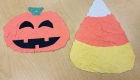 The finished project: a jack o'lantern and candy corn made from torn paper