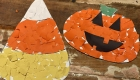 Kids can make these candy corn and pumpkin decorations by tearing and gluing colored paper.